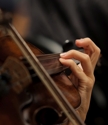 hands playing a string instrument