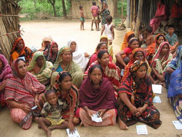 Photo of women receiving microcredit information