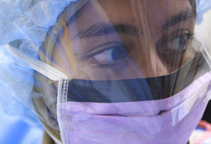 Student wearing face shield in a lab