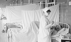 nurse with pateint during spanish influenza outbreak